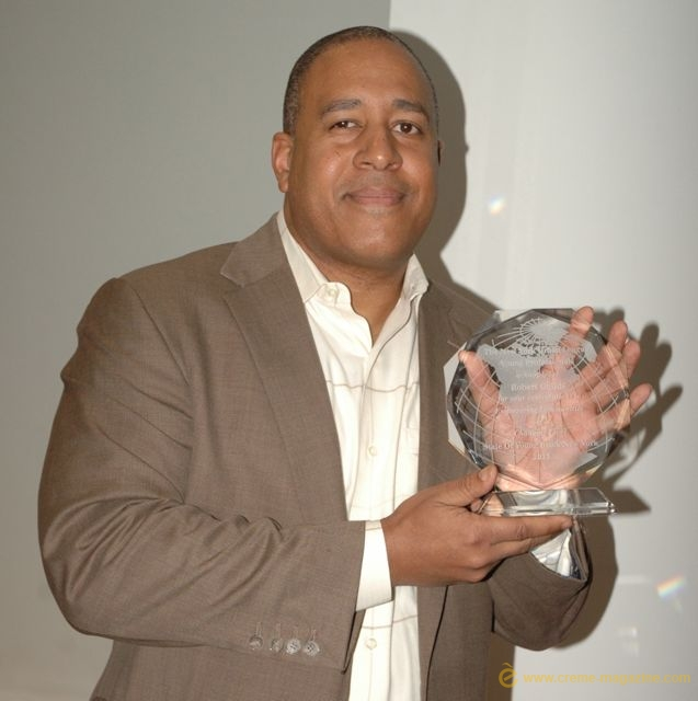 Keynote Speaker Robert Childs receives an award from NYULYP.